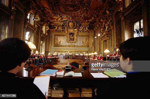 Judges and lawyers attend a session of the Paris Final Court of Appeal part of the Law Courts in Paris September 1990 marks the bicentennial of the...