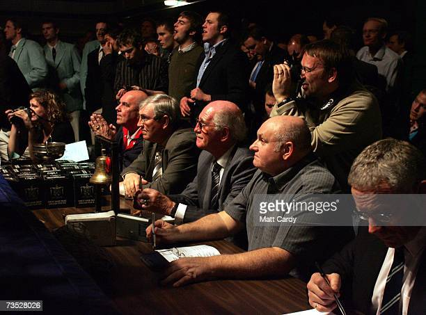 Judges and officials watch the ring as they wait for the 100th Varsity boxing match between Oxford University and Cambridge University at York Hall...