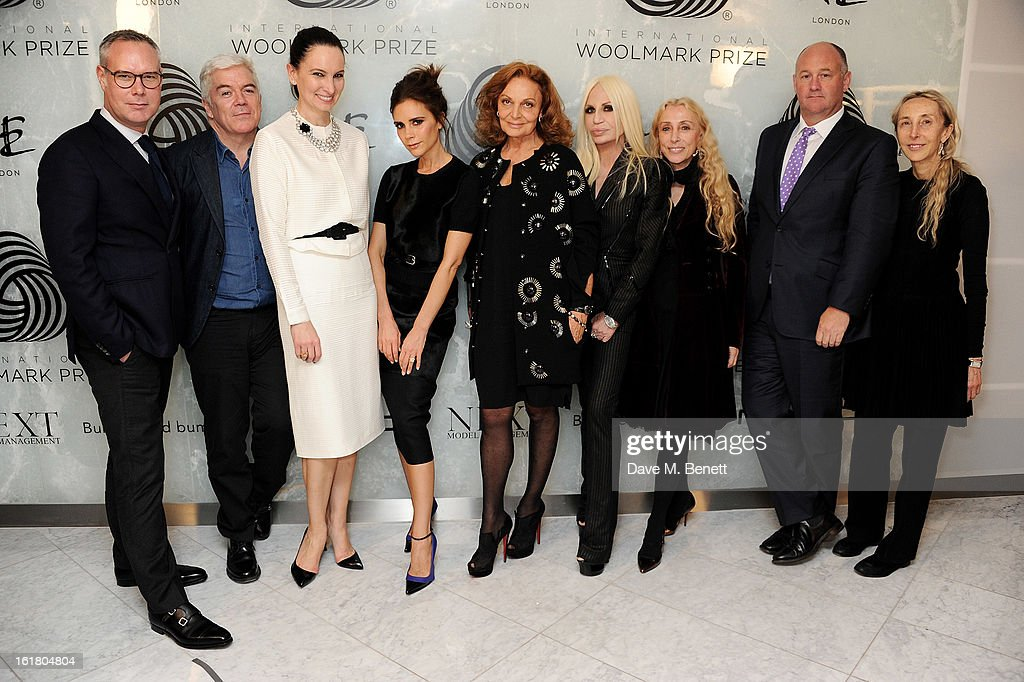 (L to R) Judges Andrew Keith, Tim Banks, Paula Reed, Victoria Beckham, Diane von Furstenberg, Donatella Versace, Franca Sozzani, Woolmark CEO Stuart McCullough and Carla Sozzani attend the 2013 International Woolmark Prize Final at ME London on February 16, 2013 in London, England.