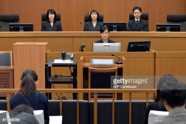 Judges are seen at a judgment trial court of Chisako Kakehi at the Kyoto district court on November 7 2017 Kakehi a onetime millionairess dubbed the...