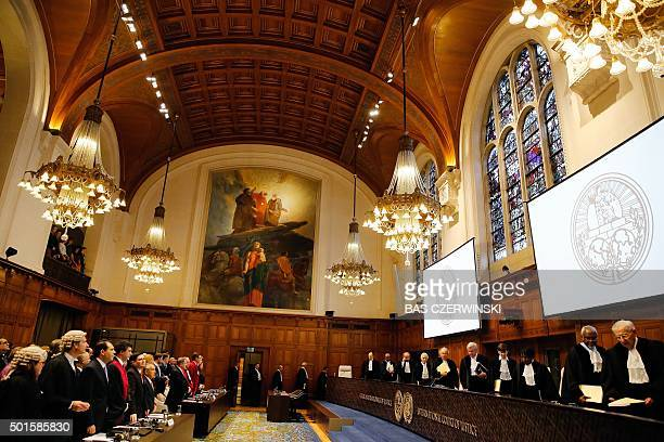 Judges arrive for the court case of the border dispute between Costa Rica and Nicaragua at the International Court of Justice in the Hague the...