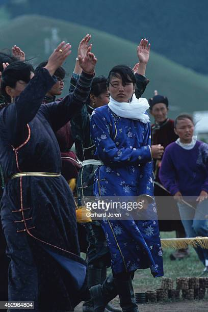 Judges at an archery competition. The sport of archery originated around the 11th century, during the time of Khanate warfare. The judges stand near...