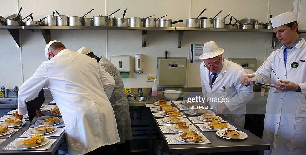 Judges at the World Scotch Pie Championship inspect pies during judging at Lauder College November 7, 2007 in Dunfermline, Scotland. A total of 70 bakers and butchers will vie for the coveted title of World Scotch Pie Champion.