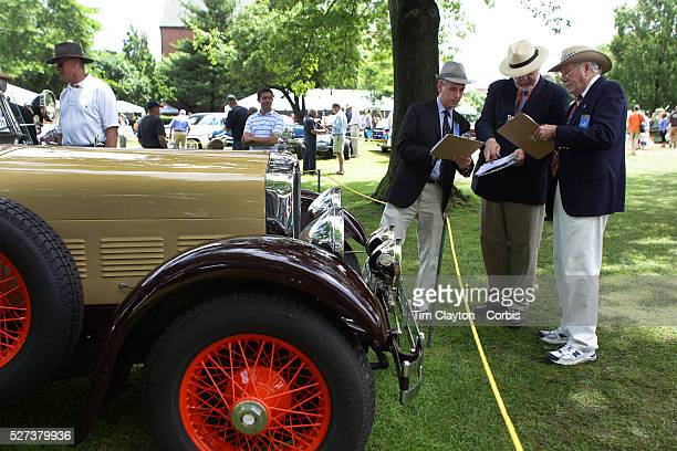 Judges compare notes at the Greenwich Concours d'Elegance Festival of Speed and Style featuring great classic vintage cars. Roger Sherman Baldwin...