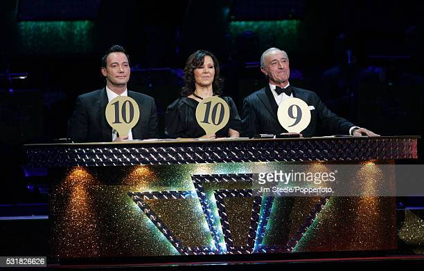 Judges Craig Revel Horwood Arlene Phillips and Len Goodman give Flavia Cacace and Matt Di Angelo the highest marks of the evening during the Strictly...