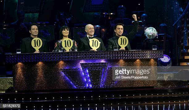 Judges Craig Revel Horwood Arlene Phillips Len Goodman and Bruno Tonioli awarding a 'perfect 10' during the Strictly Come Dancing Live event at...
