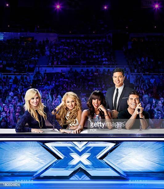 Judges Demi Lovato Paulina Rubio Kelly Rowland host Mario Lopez and judge Simon Cowell on THE X FACTOR Season three of THE X FACTOR premieres...