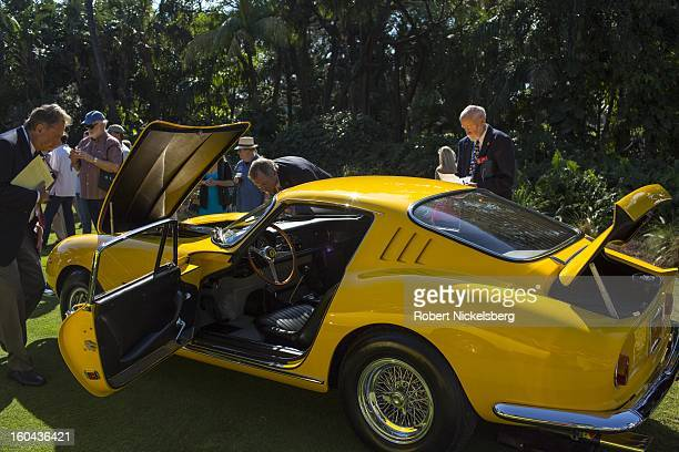 Judges discuss the quality of an antique Ferrari 275 GTB/4 automobile at the annual Cavallino Auto Competition January 26 2013 held at The Breakers...