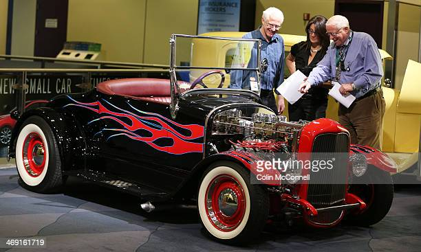 Judges Doug Devine Marie Sutherland and Norris McDonald judging Classic cars and Hot Rods on display for the Canadian International Auto Show being...