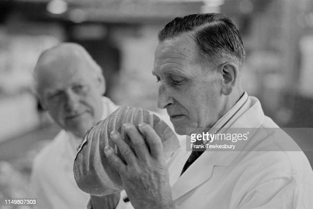 Judges examining loafs of bread at a baking competition UK 24th October 1975
