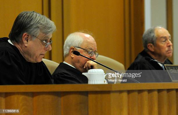 Judges Frank A Shepherd Gerald B Cope Jr and Vance E Salter listen to oral arguments in the appeal case of Martin Gill's adoption of two boys...