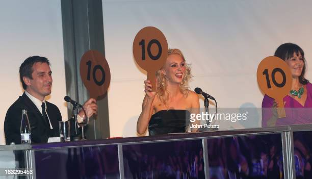 Judges Gary Neville, Camilla Dallerup and Arlene Phillips watches from the judges panel as part of Dancing with United, in aid of the Manchester...