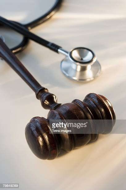 Judge's gavel next to stethoscope