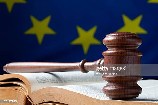 Judges gavel on book with flag in back