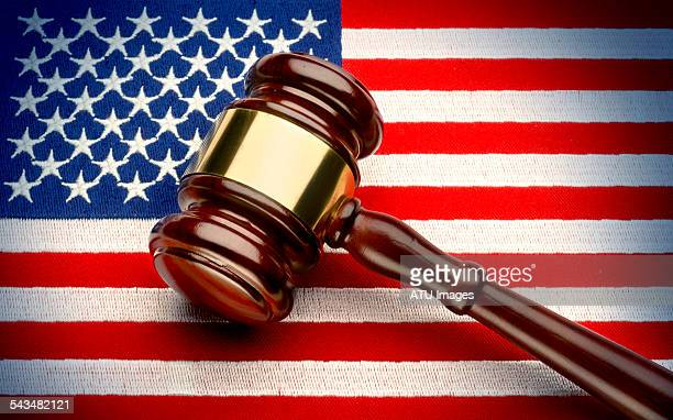Judge's gavel on flag
