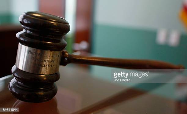 A Judges Gavel Rests On Top Of Desk In The Courtroom Newly Opened