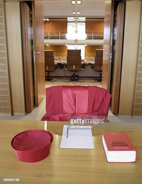 Judge's gown of the german Federal Constitutional Court Bundesverfassungsgerichts BVG consisting of a red robe white barrister's bands and a red...