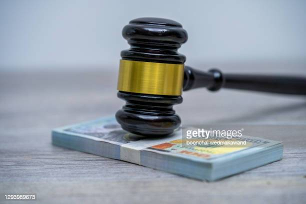 judge's hammer gavel and bank note.representation of corruption and bribery in the judiciary. - bail law stock pictures, royalty-free photos & images
