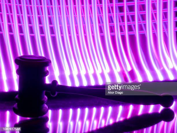 judge's hammer. lines in the form of jail bars purple color background.light painting. conceptual nature - judge law stock pictures, royalty-free photos & images