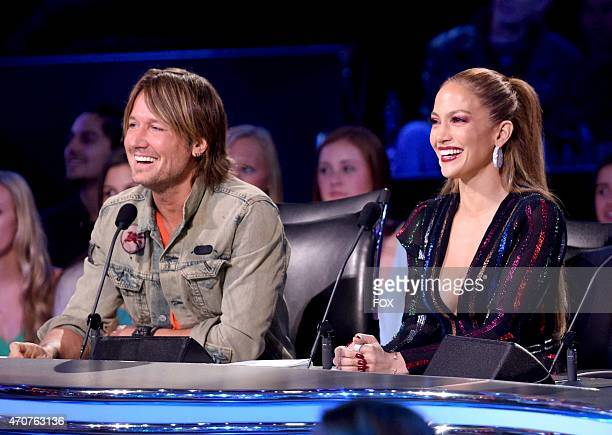 Judges Keith Urban and Jennifer Lopez onstage at FOX's American Idol XIV Top 5 Revealed on April 22 2015 in Hollywood California