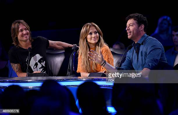 Judges Keith Urban Jennifer Lopez and Harry Connick Jr onstage at FOX's American Idol XIV Top 12 Revealed on March 11 2015 in Hollywood California