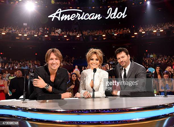 Judges Keith Urban Jennifer Lopez and Harry Connick Jr onstage at FOX's 'American Idol XIV' Top 2 Revealed on May 12 2015 at the Dolby Theater in...