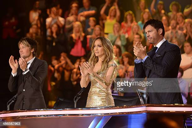 Judges Keith Urban Jennifer Lopez and Harry Connick Jr onstage at FOX's American Idol XIII Top 6 to 5 Live Elimination Show on April 24 2014 in...