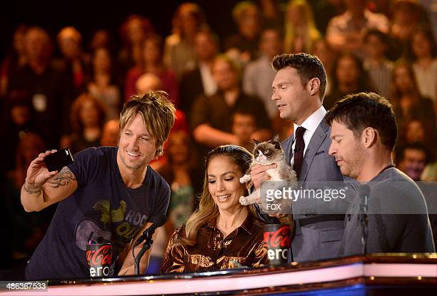 Judges Keith Urban Jennifer Lopez Grumpy Cat host Ryan Seacest and judge Harry Connick Jr onstage at FOX's 'American Idol XIII' Top 6 Live...