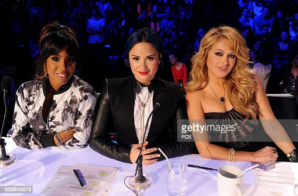 Judges Kelly Rowland Demi Lovato and Paulina Rubio on FOX's 'The X Factor' Season 3 Top 6 Live Performance Show on December 4 2013 in Hollywood...
