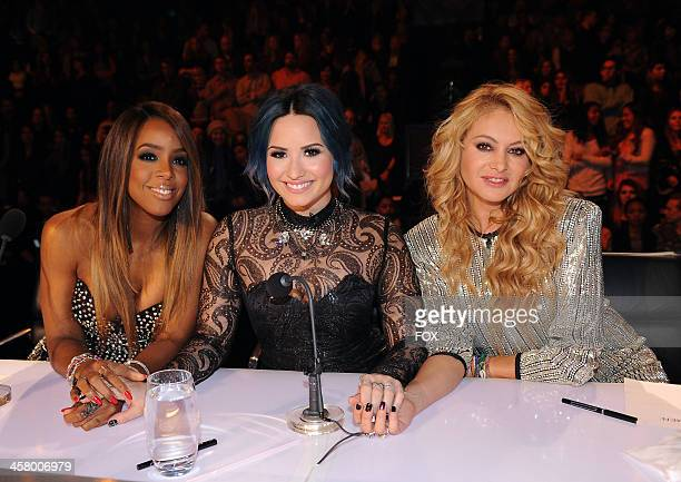 Judges Kelly Rowland Demi Lovato and Paulina Rubio on FOX's 'The X Factor' Season 3 Live Finale on December 19 2013 in Hollywood California