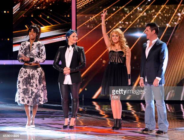 Judges Kelly Rowland Demi Lovato Paulina Rubio and Simon Cowell on FOX's 'The X Factor' Season 3 Top 6 Live Performance Show on December 4 2013 in...