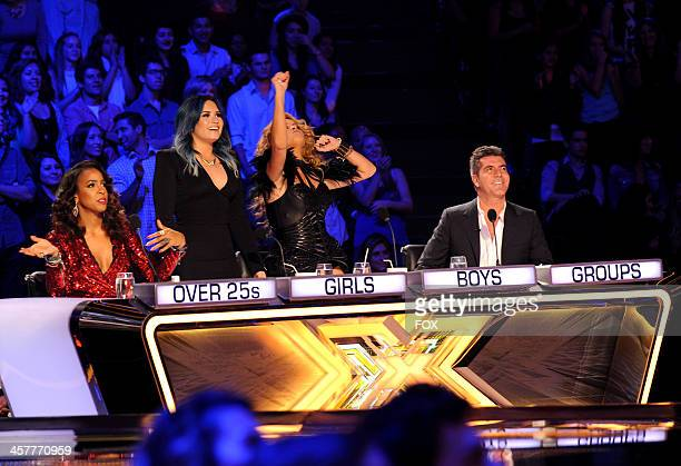 """Judges Kelly Rowland, Demi Lovato, Paulina Rubio and Simon Cowell on FOX's """"The X Factor"""" Season 3 Top 3 Live Finale Performance Show on December 18,..."""