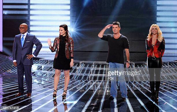Judges LA Reid Demi Lovato Simon Cowell and Britney Spears onstage at FOX's 'The X Factor' Season 2 Top 12 Live Performance Show on November 7 2012...