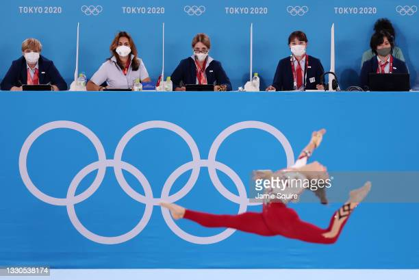 Judges look on as Pauline Schaefer-Betz of Team Germany competes in the floor exercise during Women's Qualification on day two of the Tokyo 2020...