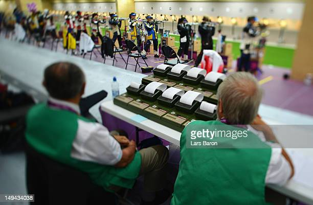 Judges look on during the Women's 10m Air Rifle Shooting qualification on Day 1 of the London 2012 Olympic Games at The Royal Artillery Barracks on...