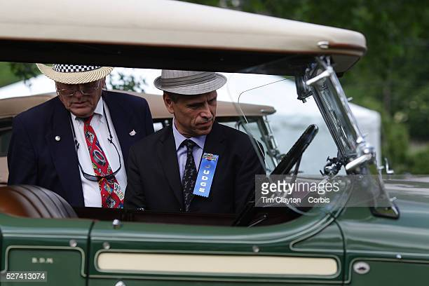 Judges make a close inspection of a 1928 Stutz BB at the Greenwich Concours d'Elegance Festival of Speed and Style featuring great classic vintage...