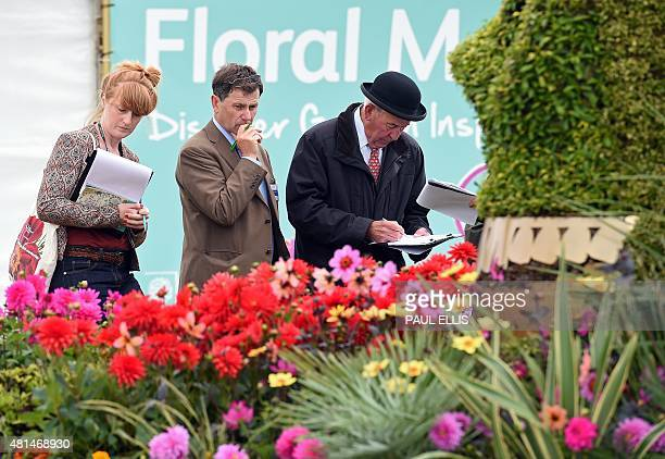 Judges make notes as they look around the exhibits during the preview day of the Royal Horticultural Society Flower Show at Tatton Park near...