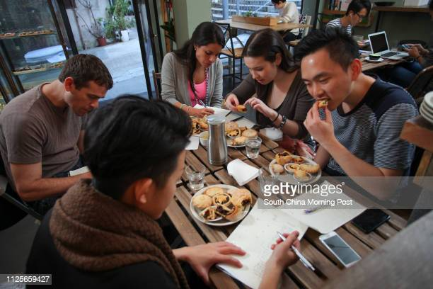 Judges May Chow , Jack Carson Alejandra Wilkinson , Rachel Reed and Joshua Ng taste mince pies at Common Grand Cafe in Sheung Wan. 02DEC13...