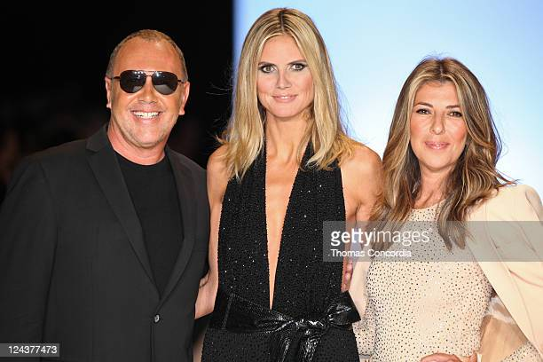 Judges Michael Kors Heidi Klum and Nina Garcia pose at the Project Runway 2012 fashion show during MercedesBenz Fashion Week at The Theater at...