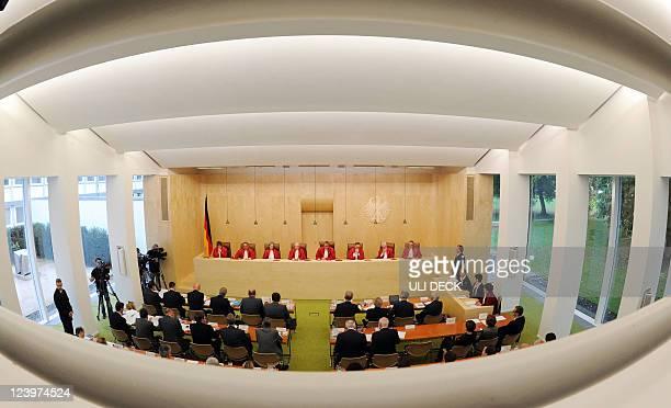 Judges of the second senate of the German Constitutional Court Monika Hermanns Herbert Landau Gertrude LuebbeWolff Udo Di Fabio Andreas Vosskuhle...