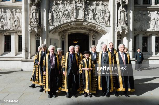 Judges of the Supreme Court including the newly appointed Lady Justice Arden and Lord Justice Kitchin pose outside the court building ahead of the...