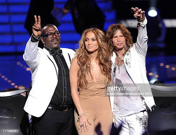 """Judges Randy Jackson, Jennifer Lopez, and Steven Tyler walk onstage during Fox's """"American Idol 2011"""" finale results show held at Nokia Theatre LA..."""
