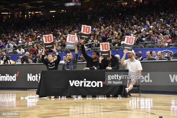 Judges rate John Jordan of the Raptors 905 after he dunks the ball during the 2017 NBA Development League Slam Dunk Contest as a part of 2017 AllStar...