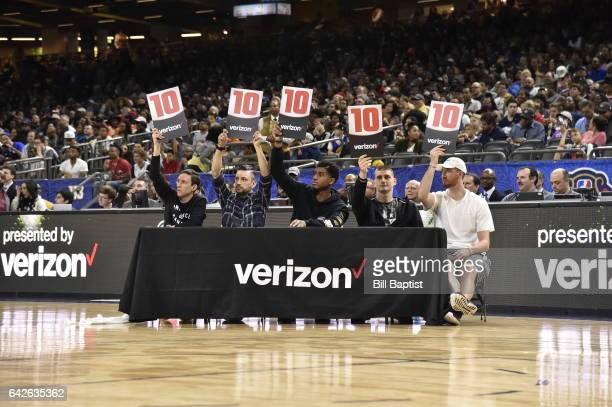 Judges rate Troy Williams of the Iowa Energy after he dunks the ball during the 2017 NBA Development League Slam Dunk Contest as a part of 2017...