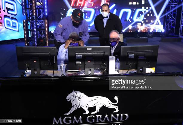 Judges review replay of Joshua Franco vs Andrew Moloney for the WBA super flyweight title at the MGM Grand Conference Center on November 14, 2020 in...