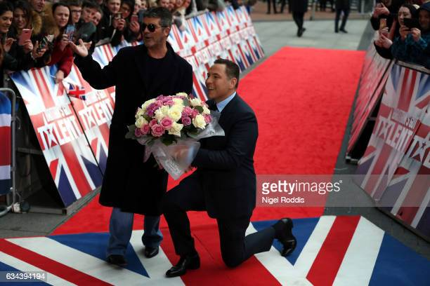 Judges Simon Cowell and David Walliams arrive for the Britain's Got Talent Manchester auditions on February 9 2017 in Manchester United Kingdom
