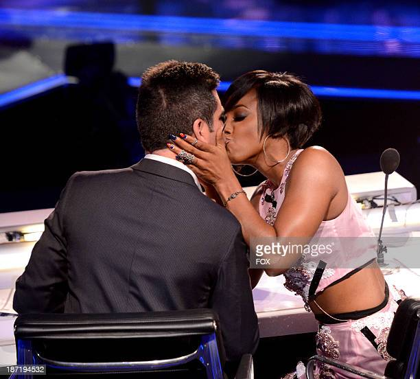 Judges Simon Cowell and Kelly Rowland on FOX's 'The X Factor' Season 3 Top 13 Live Performance Show on November 6 2013 in Hollywood California