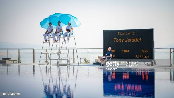 judges sitting on chairs near swimming pool - judge sports official stock pictures, royalty-free photos & images