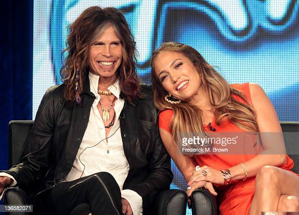 Judges Steven Tyler and Jennifer Lopez speak onstage during the 'American Idol' panel during the FOX Broadcasting Company portion of the 2012 Winter...