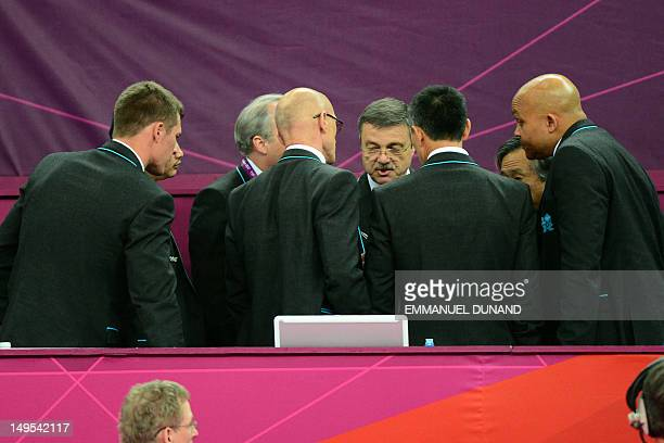 Judges talk after an appeal by Japan in the men's team final of the artistic gymnastics event of the London Olympic Games on July 30 2012 at the 02...